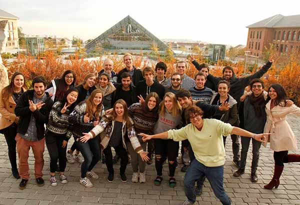group photo of students in Chili with background of the country