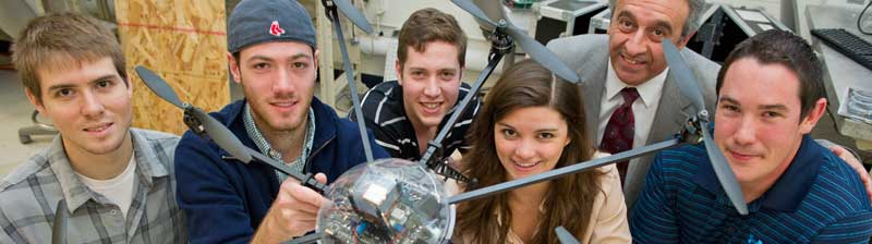 students in group holding robotic drone