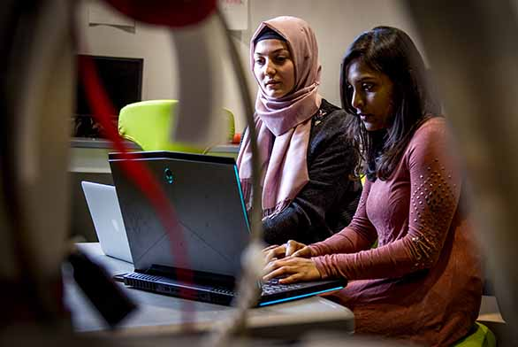 two women working at computer