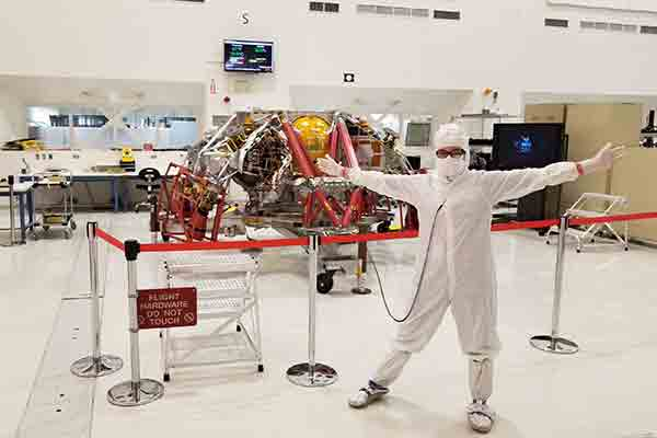 student on co-op at NASA in clean room outfit in lab
